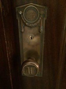 photo of brass doorknob with book detail