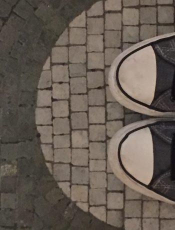 sneakers on a tile floor