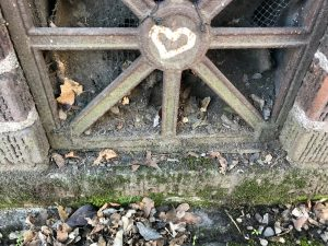 heart graffitied onto a metal grate